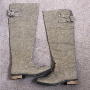 Over the knee cream boots